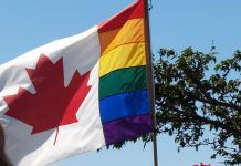 The symbol flag of LGBTQ community at Pride Parade, Vancouver, BC; Photo by ©the Pacific Post